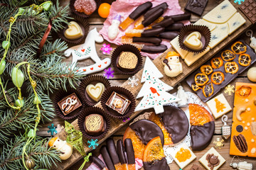 Chocolate candy, citrus fruit, dessert, oranges with Christmas symbols