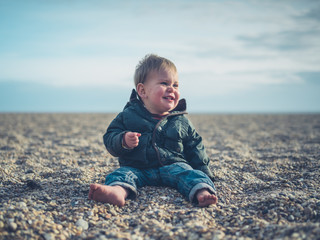 Cute little baby on the beach