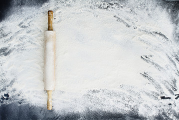 Rolling Pin Over Flour Background