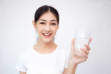 Young Asian Woman holding water with smile on white background.