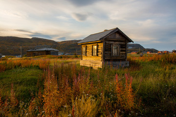 Old wooden house at sunset in Teriberka. Russia