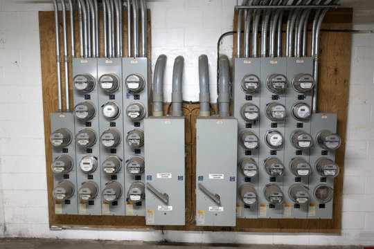 A gaggle of electric meters in the basement for an apartment building. St Paul Minnesota MN USA