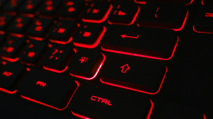 Computer keyboard with red backlight