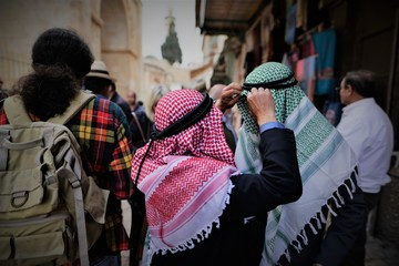 Traditional hats and kaffiyah are seen in the old city of jerusalem all year round