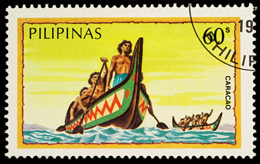 Group of the natives in traditional boat (caracao)