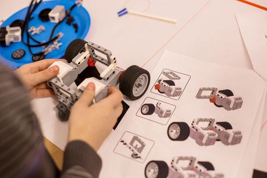 Child making robot car machine. Hobby concept