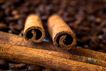 Cinnamon stick on the background of coffee