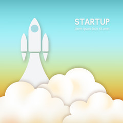 startup concept. rocket flying up in sky