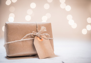 Small gift box on abstract light background