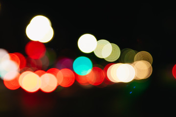 Blurred Christmas lights on a black background, bokeh. Light bokeh abstract. The concept of the new year 2018, holidays, vacation.