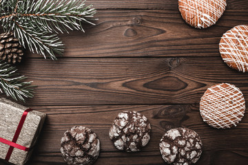 Brown wood background. greeting card. Fir tree, decorative cone. Sweets. Message space for Christmas and New Year. Gifts for xmas. Xmas and Happy New Year composition. Flat lay, top view