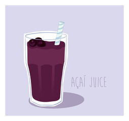 Energy drink - Acai fruit juice in a glass with a straw