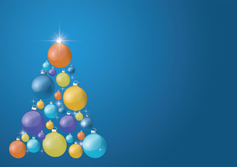 Beautiful modern Christmas tree with colorful balls on a blue background. copy-space for text .