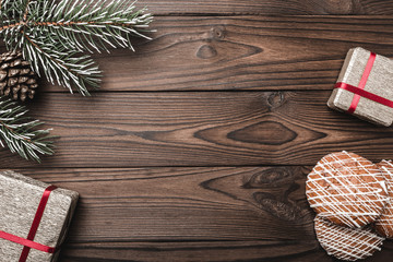 Brown wood background. Fir tree, decorative cone. Message space for Santa, Christmas and New Year. Cookies. Xmas and Happy New Year composition. Flat lay, top view, Gifts