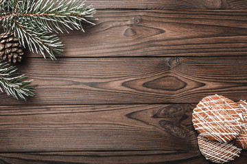 Brown wood background. Fir tree, decorative cone. Message space for Santa, Christmas and New Year. Cookies. Xmas and Happy New Year composition. Flat lay, top view