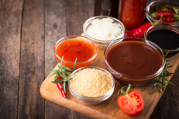 Barbeque sauce with ingredients on the table