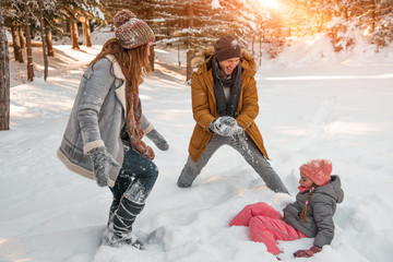 funny wintertimes with parents and child