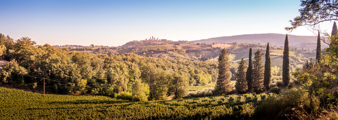 San Gimignano medieval town towers skyline and countryside landscape panorama on sunset. Tuscany, Italy, Europe