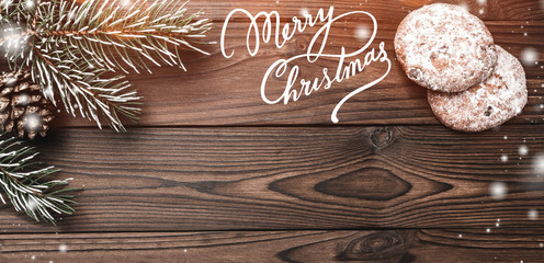 Brown wood background. Fir tree, decorative cone. Sweets. Message space for Christmas and New Year. Effect of flakes. Letter to Santa. Xmas and Happy New Year composition. Flat lay, top view.