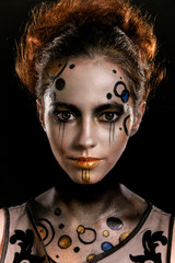 Young girl with a futuristic makeup