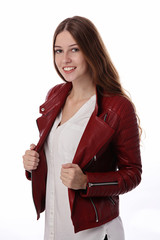 Portrait of happy smiling teenage girl wearing red leather jacket. Fashion concept
