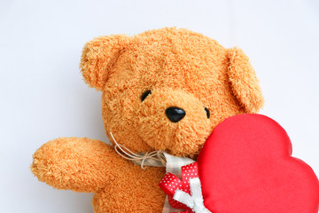 Cute Teddy bear with red heart symbol on white background