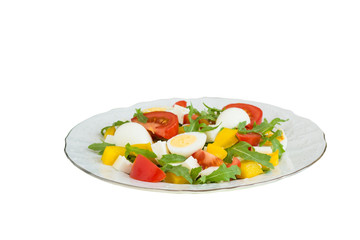 Vegetable salad on a plate on a white background.