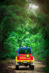 Road Trip Travel on 4WD Off Road Adventure in the Forest in Thailand - Holiday Concept