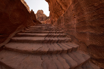 Flight of steps to achieve the treasury view from above inside the ancient city of Petra, Jordan
