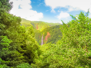 Scenic landscape in tropical rainforest of Carbet Falls or Les Chutes du Carbet, on Carbet River, Guadeloupe island, Caribbean, French Antilles. The waterfalls are one of the most popular landmarks.