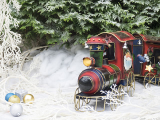 Christmas toy steam train in the winter forest.