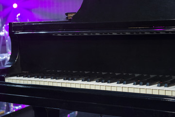 piano with lights in background