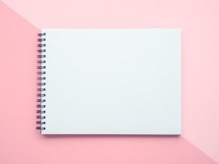 Notepad on pastel background