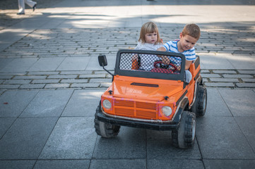 Boy and girl at car toy