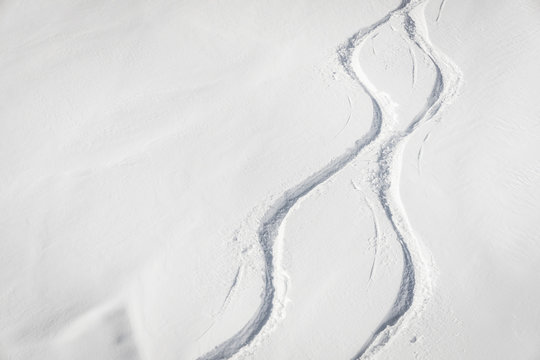 Snowboard free ride tracks in fresh powder snow