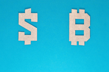 dollar and bitcoin currency symbol on blue background