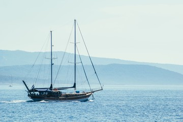 Sailboat on blue sea background