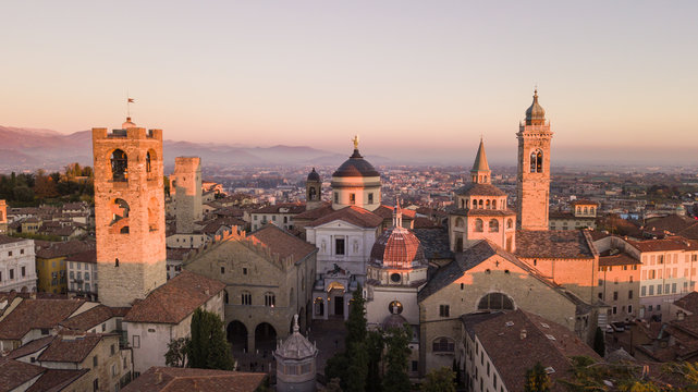 Bergamo, Italy. Drone aerial view of the Old city. One of the beautiful city in Italy. Landscape on the city center and the historical buildings during the sunset