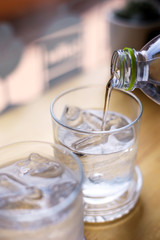A glass of pure fresh water is poured into a glass