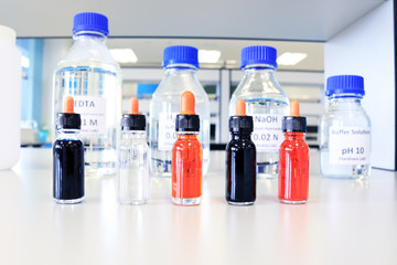 Reagent bottles with chemical in science classroom and laboratory.