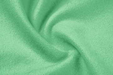 Texture, background, pattern. Woolen fabric for outdoor clothing, pale green. Colorful, fresh spring fresh green. More of this motif and more textiles in my port.