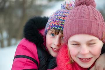 Portrait of  girlfriends in winter park.