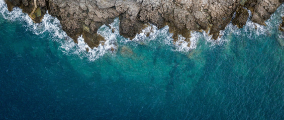 Foto op Canvas Luchtfoto Aerial view of sea waves and fantastic Rocky coast, Montenegro