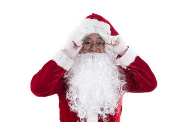 Santa standing holding his hat isolated on white background.