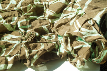 Texture, background, pattern. Women's skirt. Fabric cotton protective color khaki. Textile fabric is dull brownish-yellow in color, in particular, a strong cotton cloth