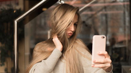 young woman in cafe makes a self photo