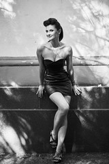 Beautiful girl in a leather dress in rock and roll slyle, black and white photo