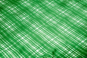 "background texture. silk fabric checkered green white. beautiful silk taffeta-twill with wicker check in the ""eternal bell"" of green and orchid."