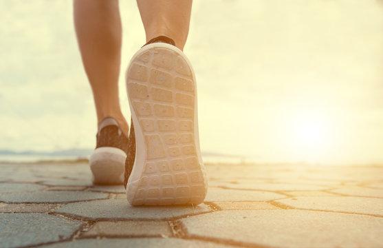 Athlete runner feet running on treadmill closeup on shoes