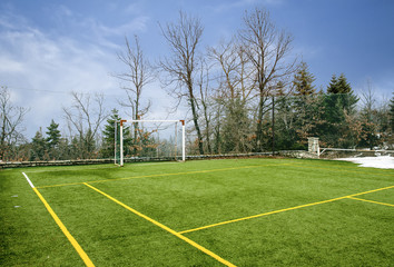 Field for soccer and other sports under blue sky with clouds at Winter